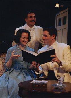 "DIAL ""M"" FOR MURDER - 2004. George Ashiotis, Pamela Sabaugh, Nicholas Viselli.George Ashiotis, Pamela Sabaugh, Nicholas Viselli. A group of three, who are dress formaly. They are looking at a book while they are smiling. There are empty drinking glasses i"
