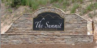 Sandblasted Sign With Stacked Rock Surround