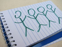 Notepad with stick figures