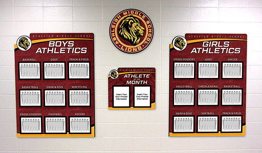 School hallway with athletic team photo displays for boys and girls teams, custom signs