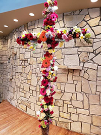 Photo of Easter Cross with flowers.
