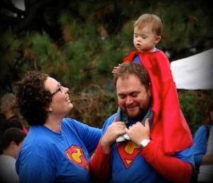 A family dressed as super heroes from a past Buddy Walk.