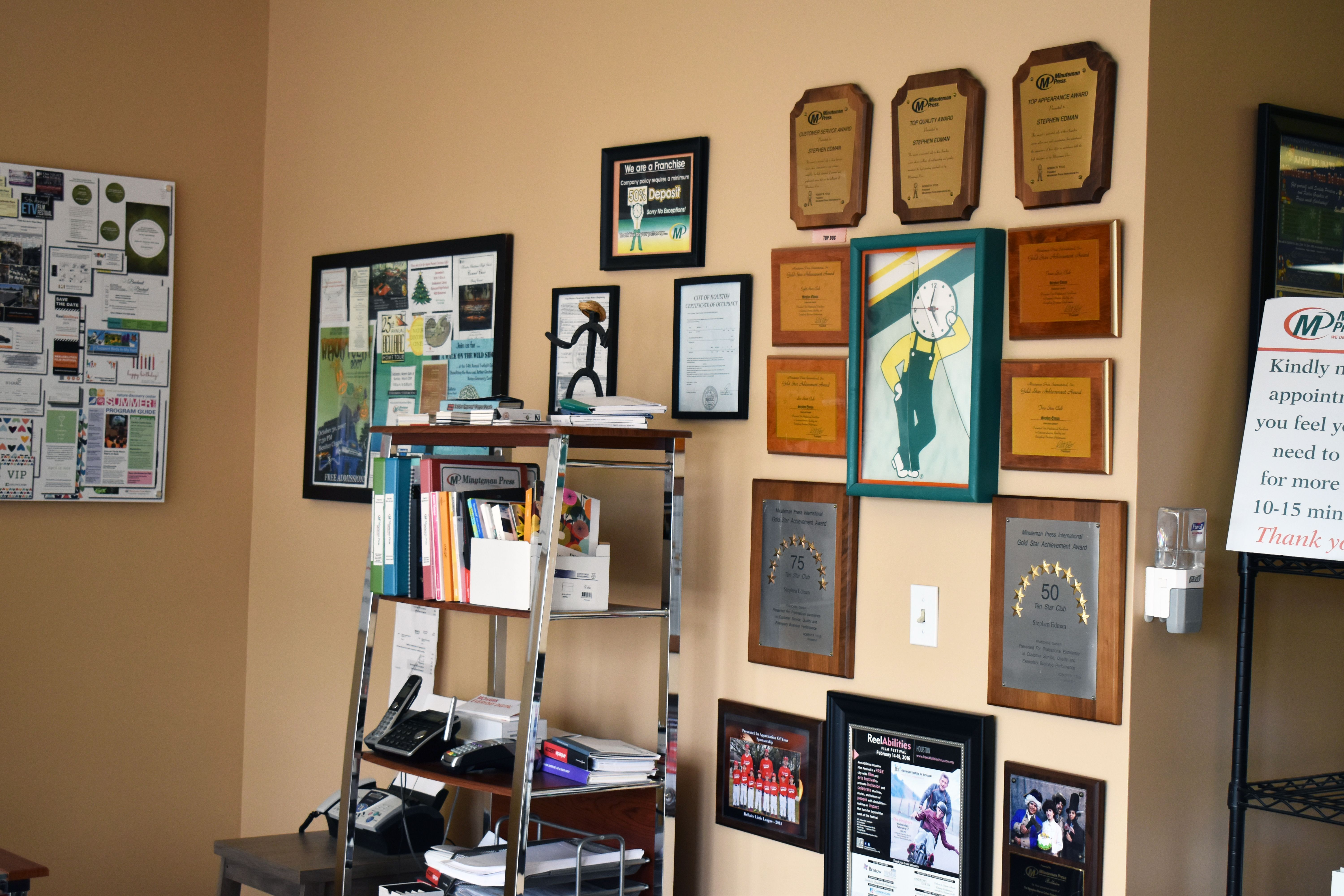 Wall of plaques and awards