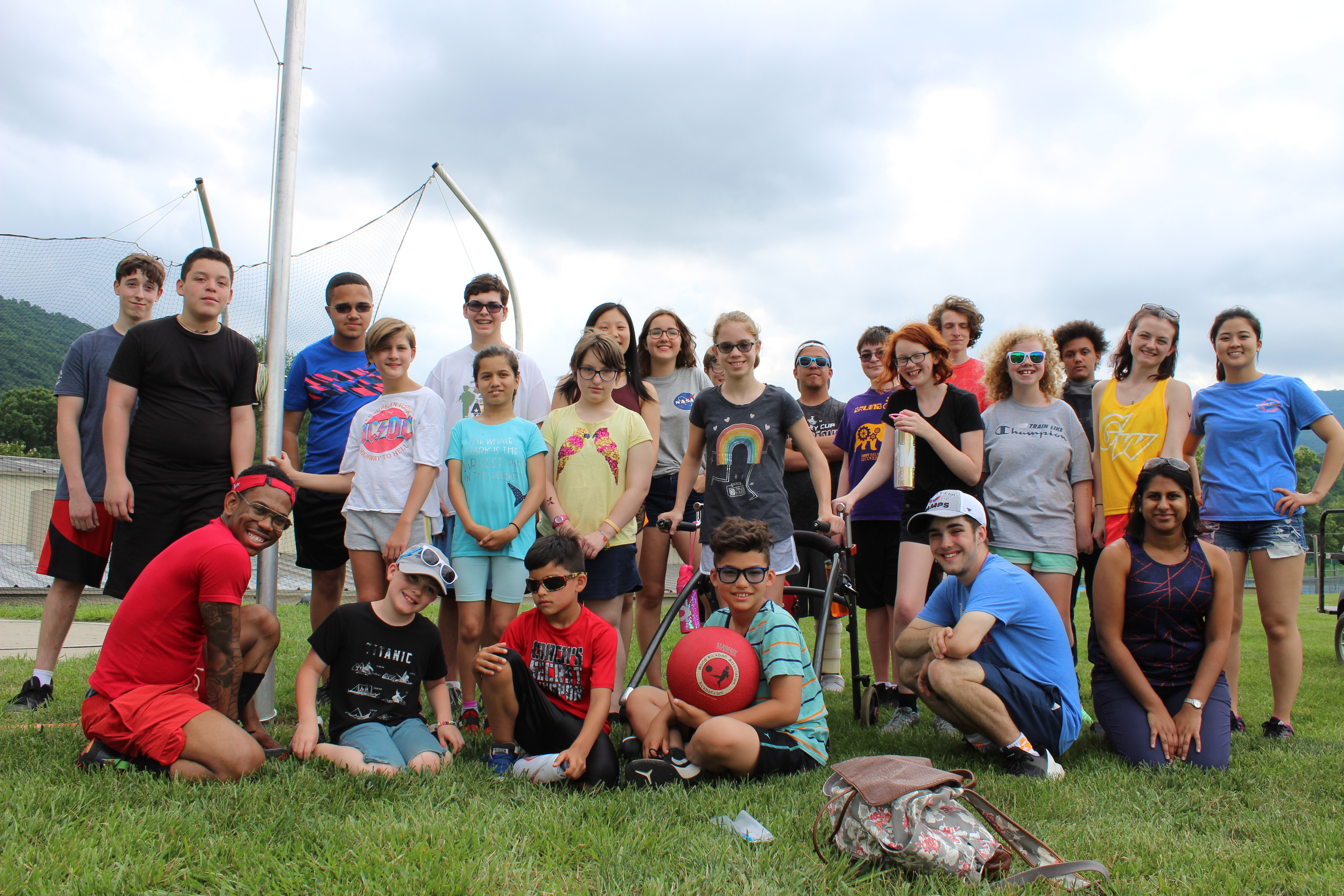 Campers and counselors pose for a photo following a game of kickball.