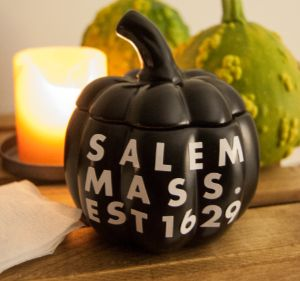 black porcelain pumpkin with text: salem mass. est 1629