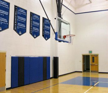 School gym with championship boards that add a year for each championship, custom signs
