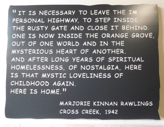 """N23177 Engraved HDU Wall Plaque with a saying by Marjorie Kinnan Rawlings  """"It is necessary to leave the impersonal highway ."""""""