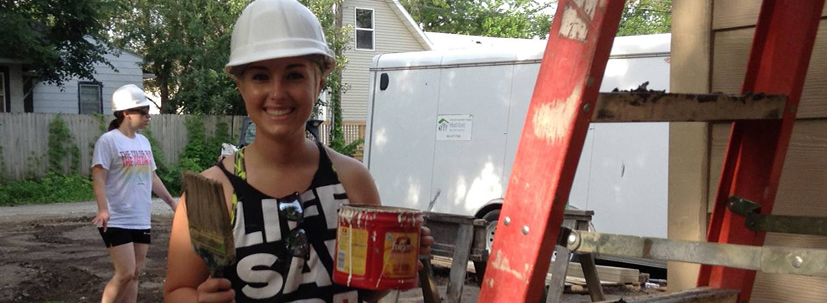 Firespring staff Sage Jensen volunteering at Habitat for Humanity.