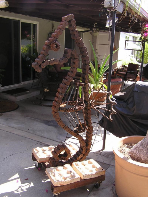 "Large Sea Horse,Metal-Scrap fork lift chain, large gears and scrap metal; 5' 8"" H; 36"" D; 30"" W; Approx. 400 lbs"