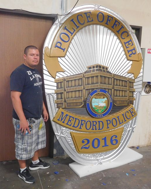 M7457 - Metallic Silver and Gold Painted Carved 3D High-Density-Urethane (HDU) Wall Plaque featuring the badge of  a Police Officer in Medford , Oregon.