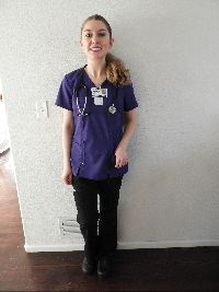Jazmine wearing nursing scrubs