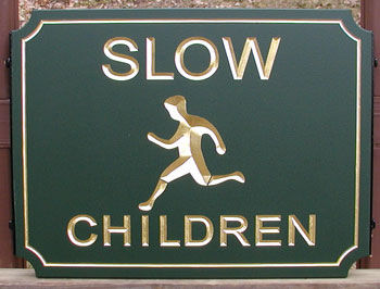 "KA20671 - Carved HDU Sign Telling Driver To Go ""Slow"" for ""Children,"" with Carved Image of Boy Running"