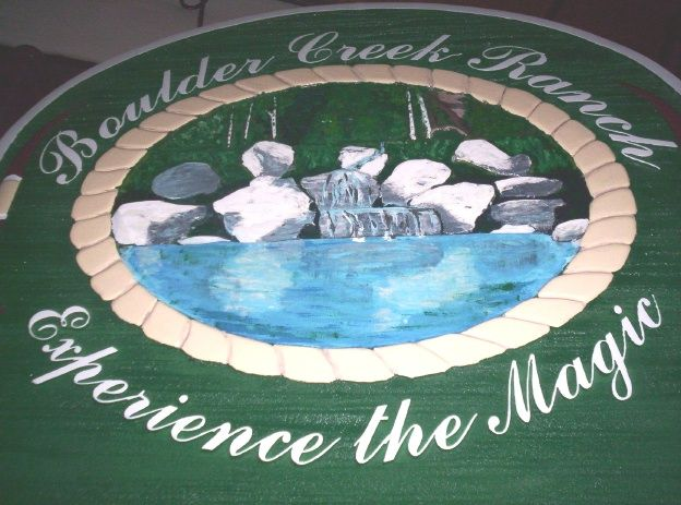 O24863 - Close-Up of  Boulder Creek Ranch Sign with Hand-Painted Boulders and Creek