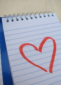 Notepad with a heart drawn on the page