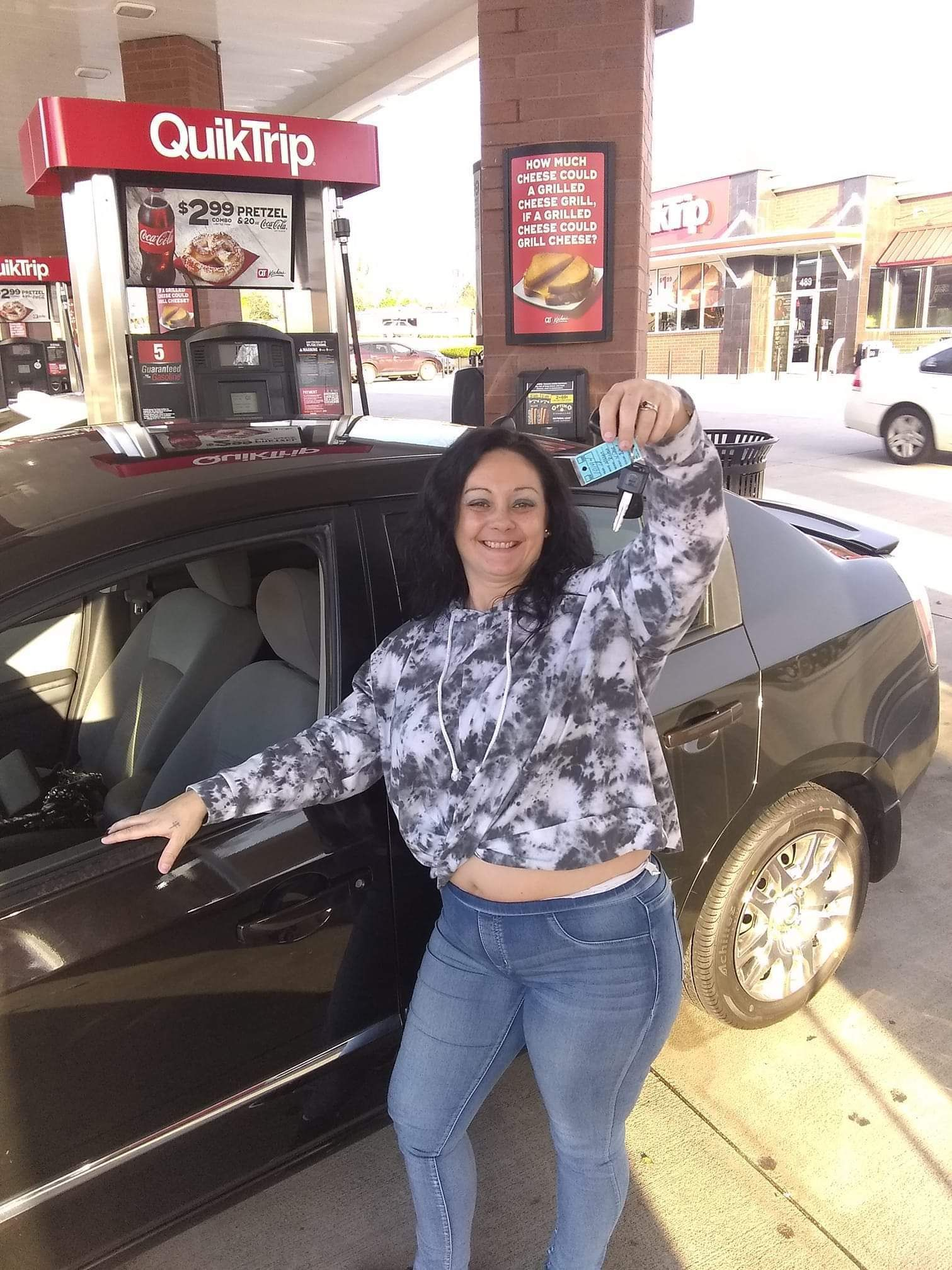 Congratulations!!! She got her CAR! See her dangling the keys!