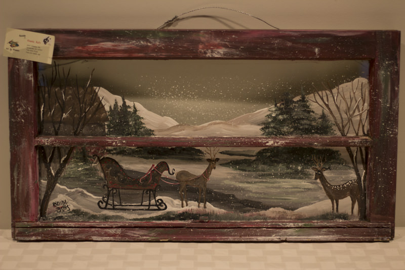 Winter scene painting on red frame - Donated by the artist, Rhonda Butts