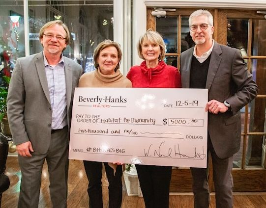 Beverly-Hanks presents holiday gift to Haywood Habitat