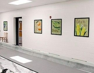 School serving line wall with nutrition education, 4 food posters in frames, watercolor style