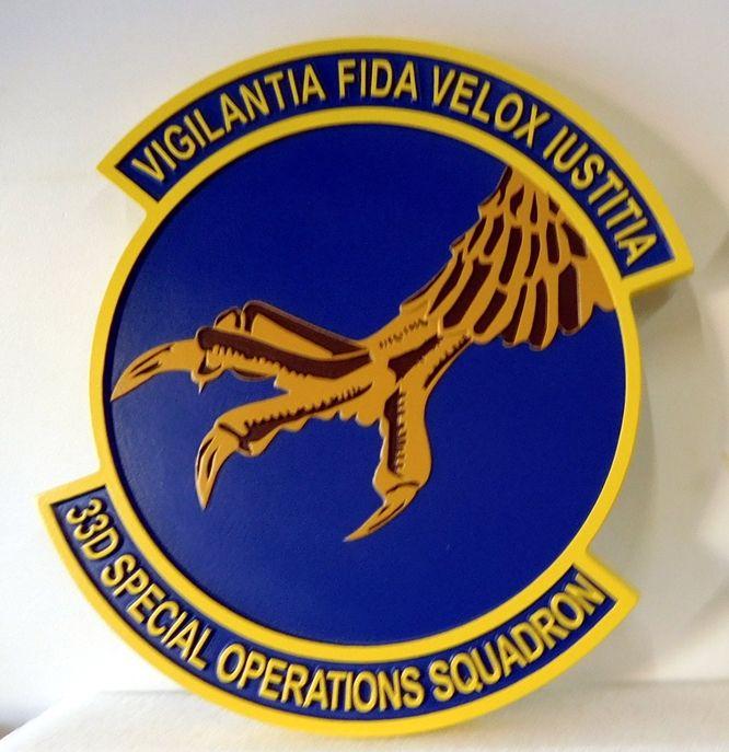 "LP-3720 - Carved Round Plaque of the Crest of the 33rd Special Operations Squadron ""Vigilantia fida velox iustitia"", Artist Painted"