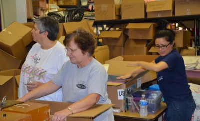 LHM volunteers prepare boxes for shipment to Liberia