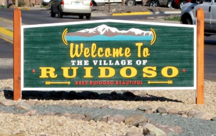 M6133 - Carved and Sandblasted entrance Sign for the Village of Ruidosa, mounted between Two Wood Posts