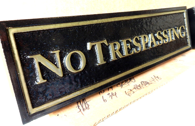 I18567 - Carved No Trespassing Sign with Raised Text and Border Painted Metallic Gold , and Glossy Finish (Side View)