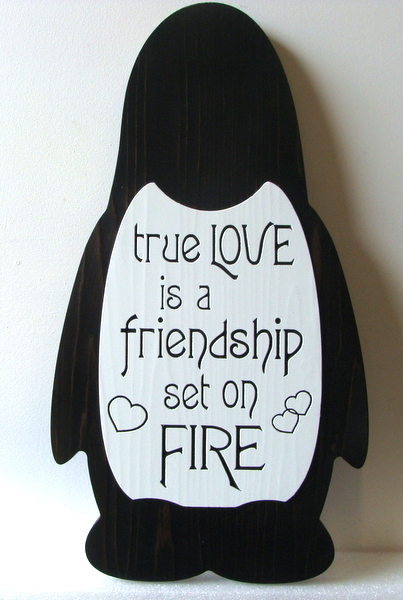 "N23068 - Penguin Wooden Wall Plaque with Engraved  Love Poem ""True Love is a Friendship Set on Fire'"