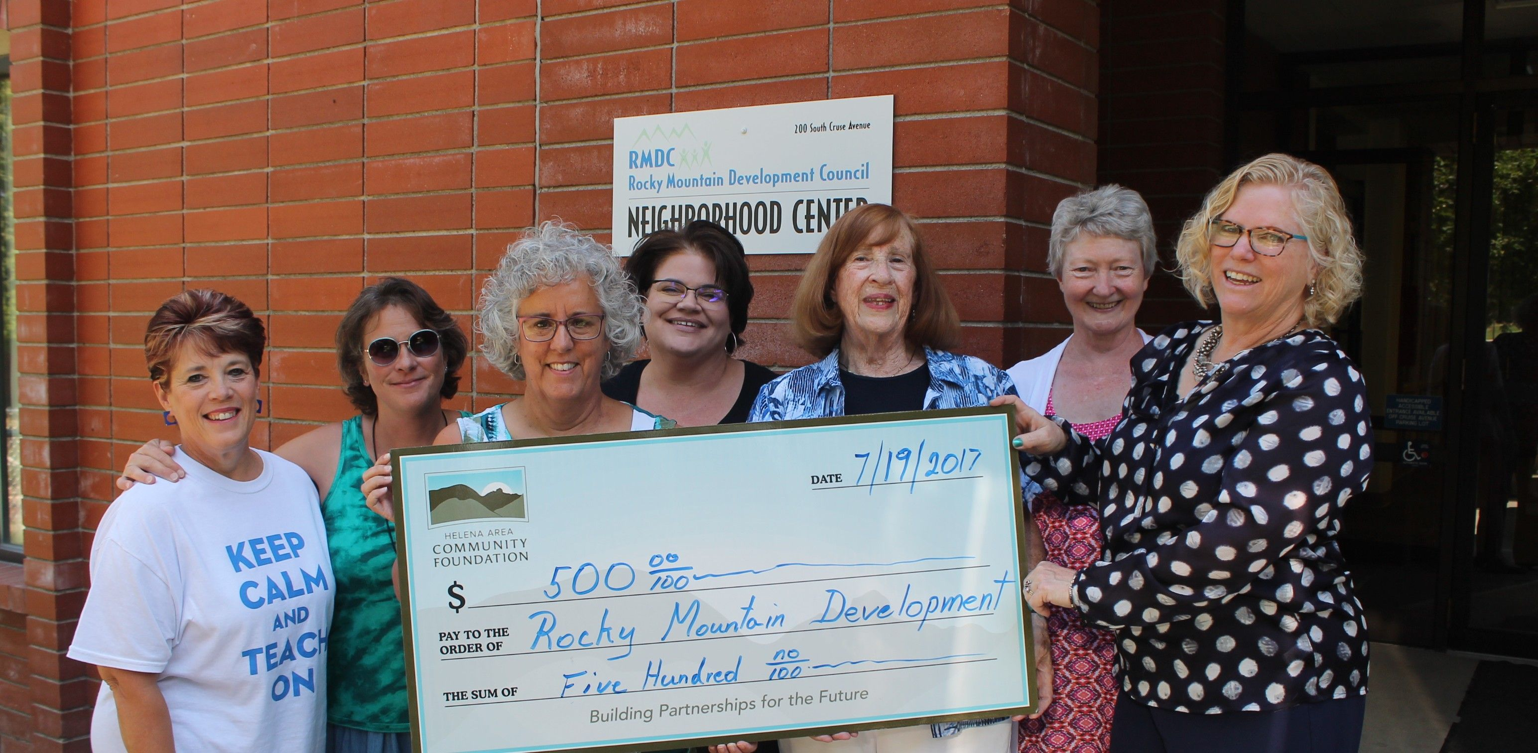 Photo of Rocky receiving a check from the Helena Area Community Foundation for creating new brochures!