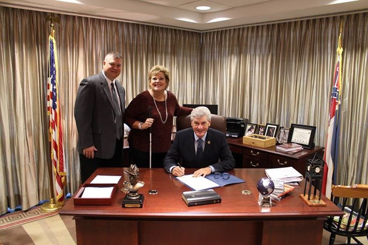 Danay and Gil Trest with Mississippi Governor Phil Bryant in his office as he signs a proclamation for Usher Syndrome Awareness Day.