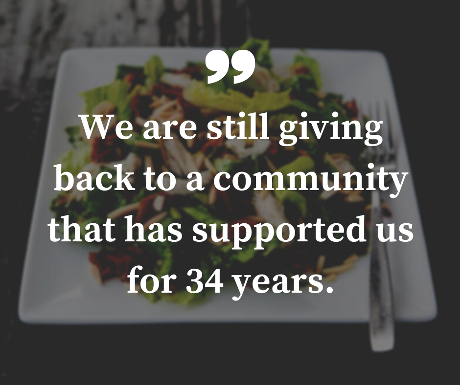 "An image of a salad from trio's restaurant in the background with a pull quote in the foreground that reads ""we are still giving backs to the community that has supported us for 34 years."""