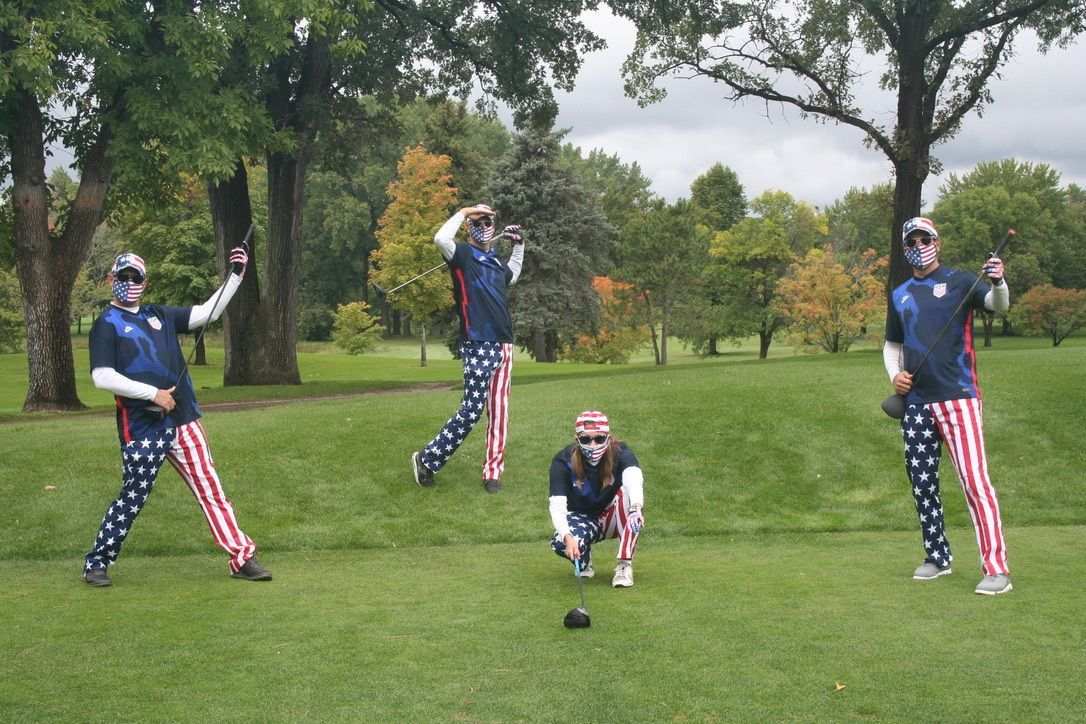 Team Claussen sporting red, white and blue while having fun on the course!