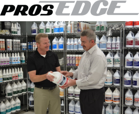 Salesman and Customer in Front of Rack of Cleaning Product