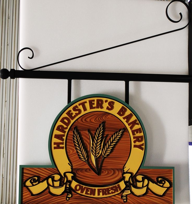 Q25570 - Carved HDU Overhead Sign for Hardester's Bakery, with Wheat Ears and Painted Faux Wood Grain as Artwork