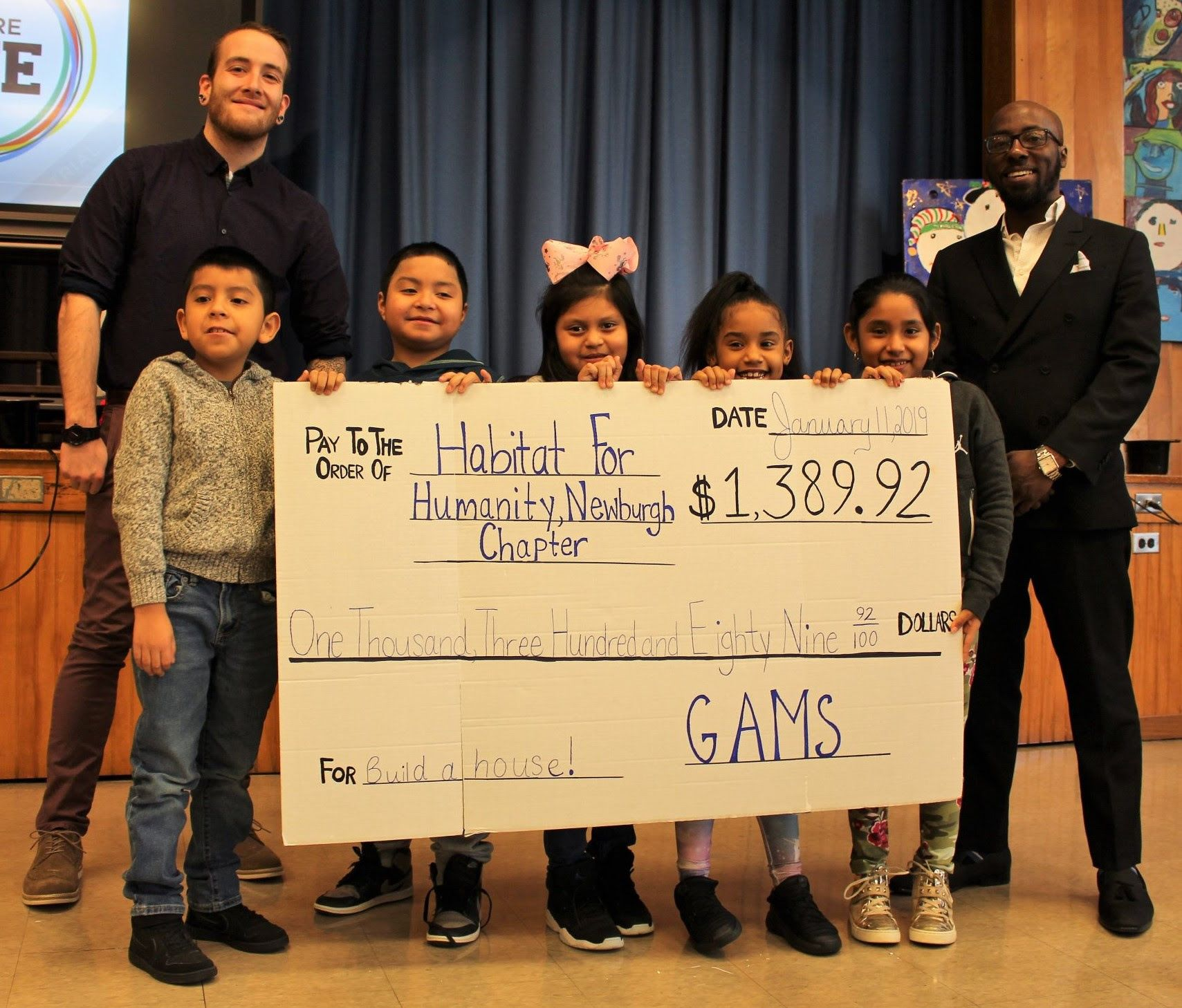 Students from GAMS present check