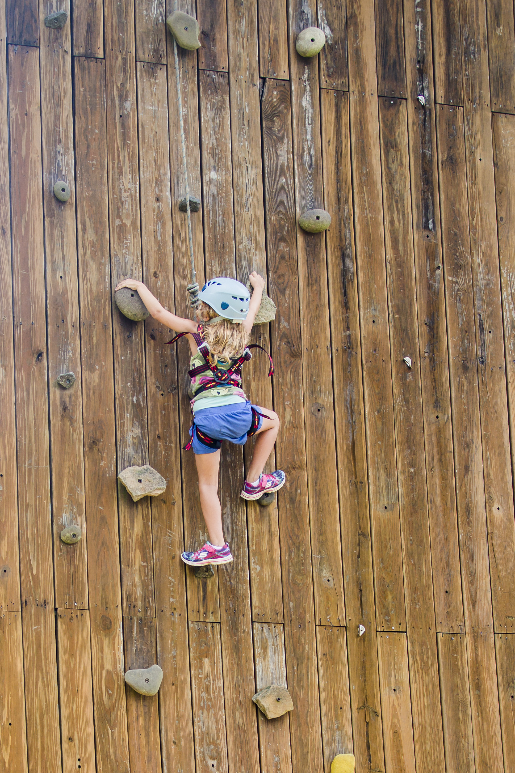 A camper climbs the rock-wall