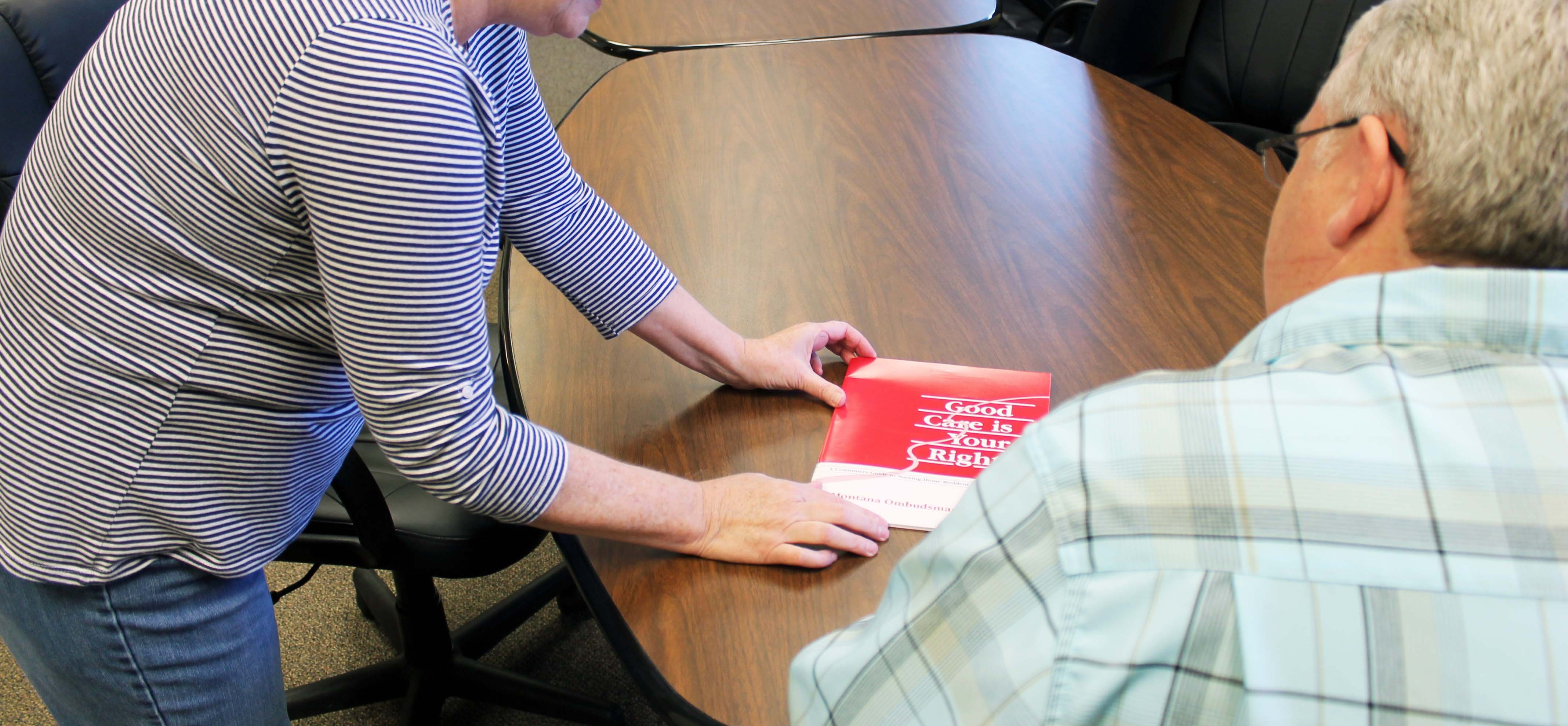 Pictured: Area IV staff member Deby working with a client.
