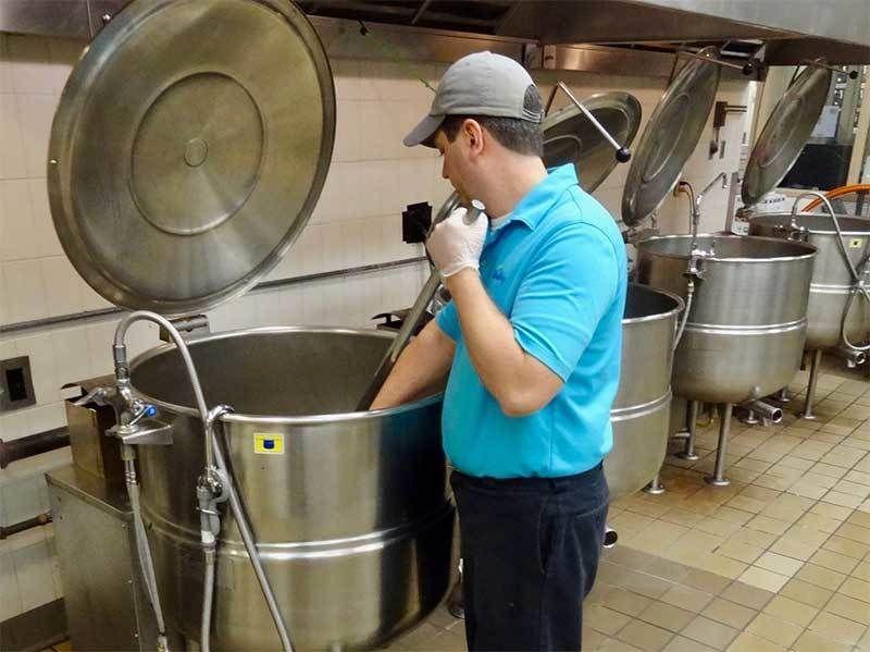 Man using kitchen equipment.