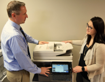Man Talking with Woman at Copier