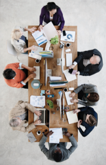 Employers business meeting around table