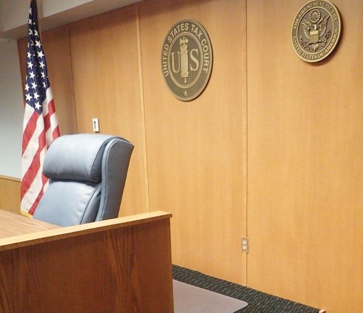 FP-1394 - Plaques of the Seals  of the US Tax Court and the USA, mounted on a wall above the Judge's Bench in a Courtroom