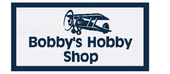 "N23604 -  2.5-D Carved  HDU  Wall Plaque,""Bobby's Hobby Shop"" , with a Small  Model Aircraft as Artwork."