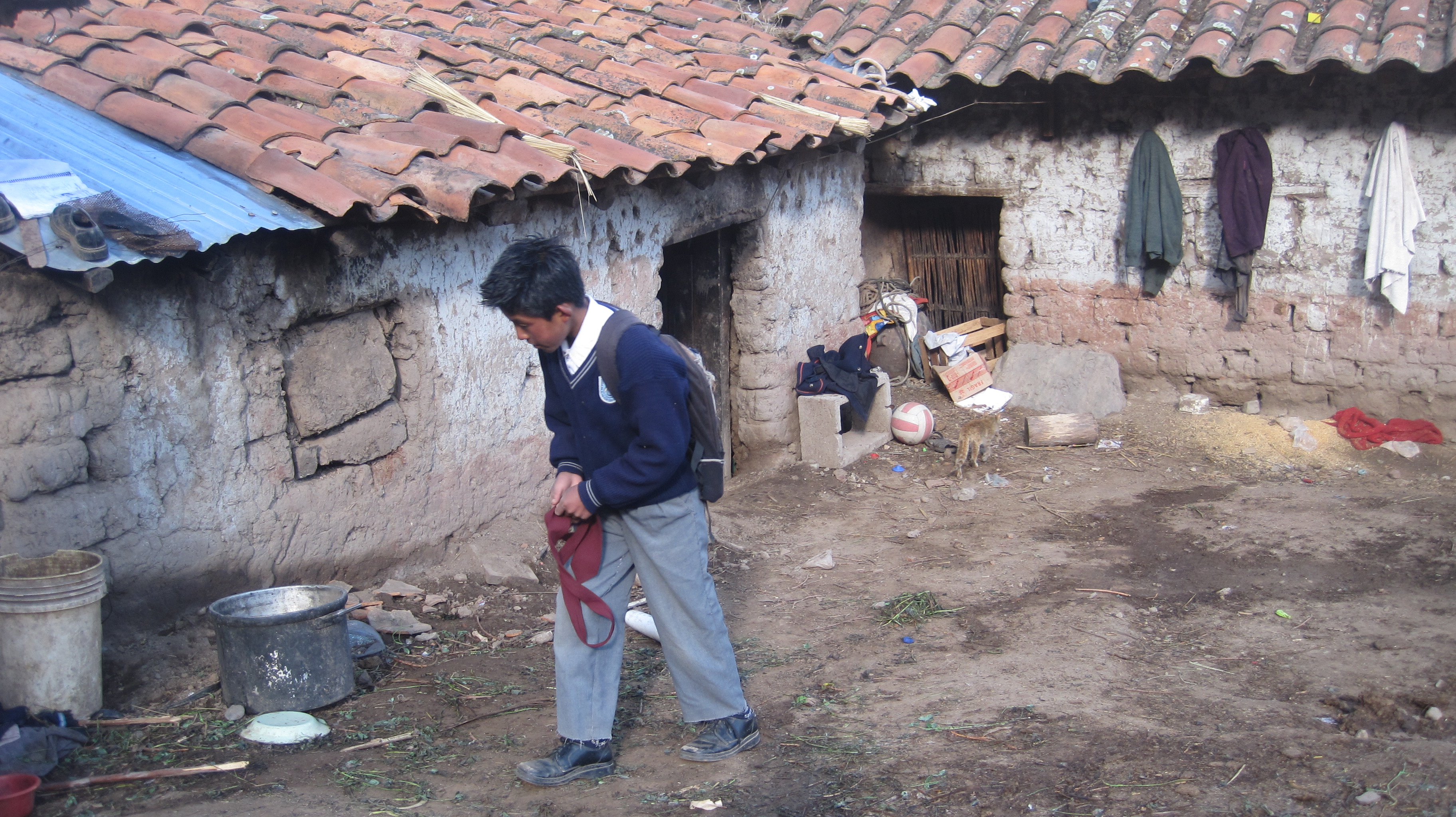 "Student of ""San José Obrero"" School in front of his home (Pomacanchi, Peru)"