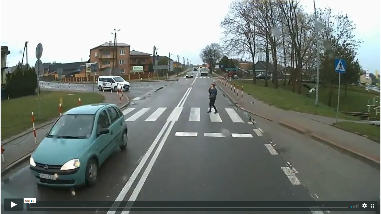 Distracted Pedestrian On Phone Steps Into Traffic