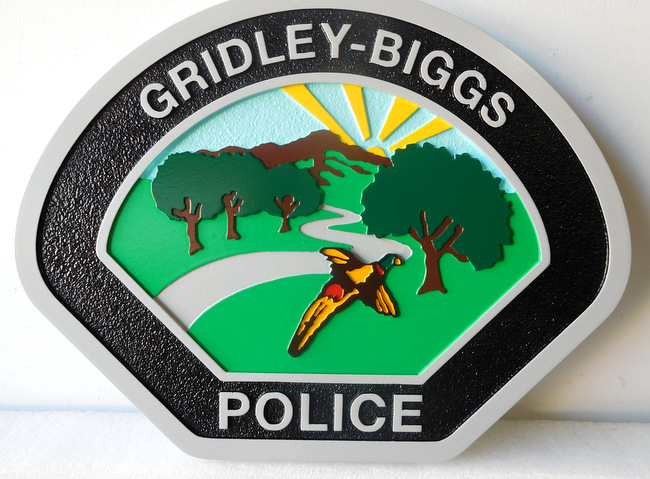 X33447 - Carved  Wall Plaque  of the Shoulder Patch of the Gridley-Biggs Police Department.