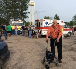 Clayton Andrews, Co-founder/CEO of Orphan Grain Train visits Pilger, NE shortly after tornado devastates the town