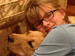A picture of Bella and her dog.