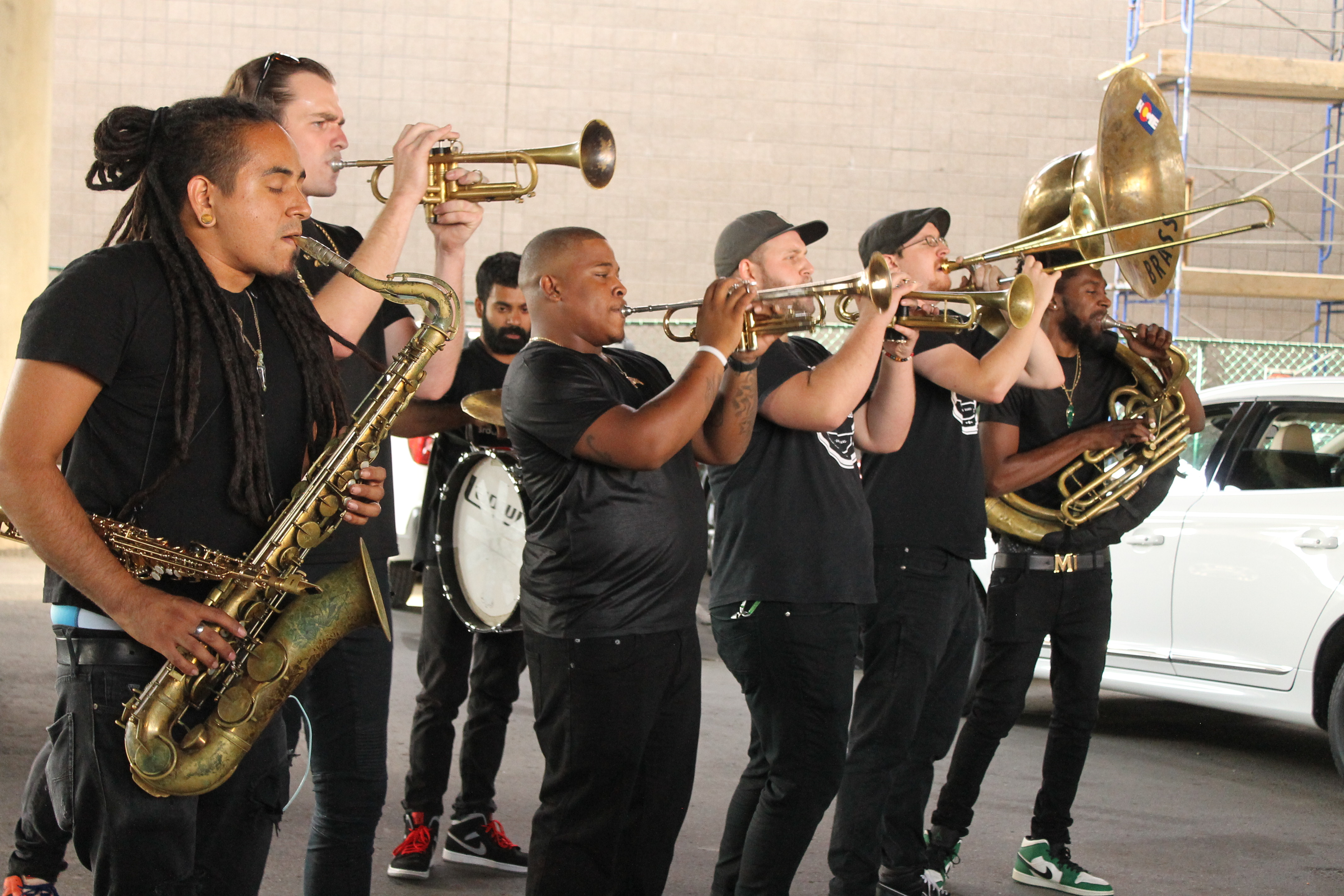 Brass band playing music in parking lot