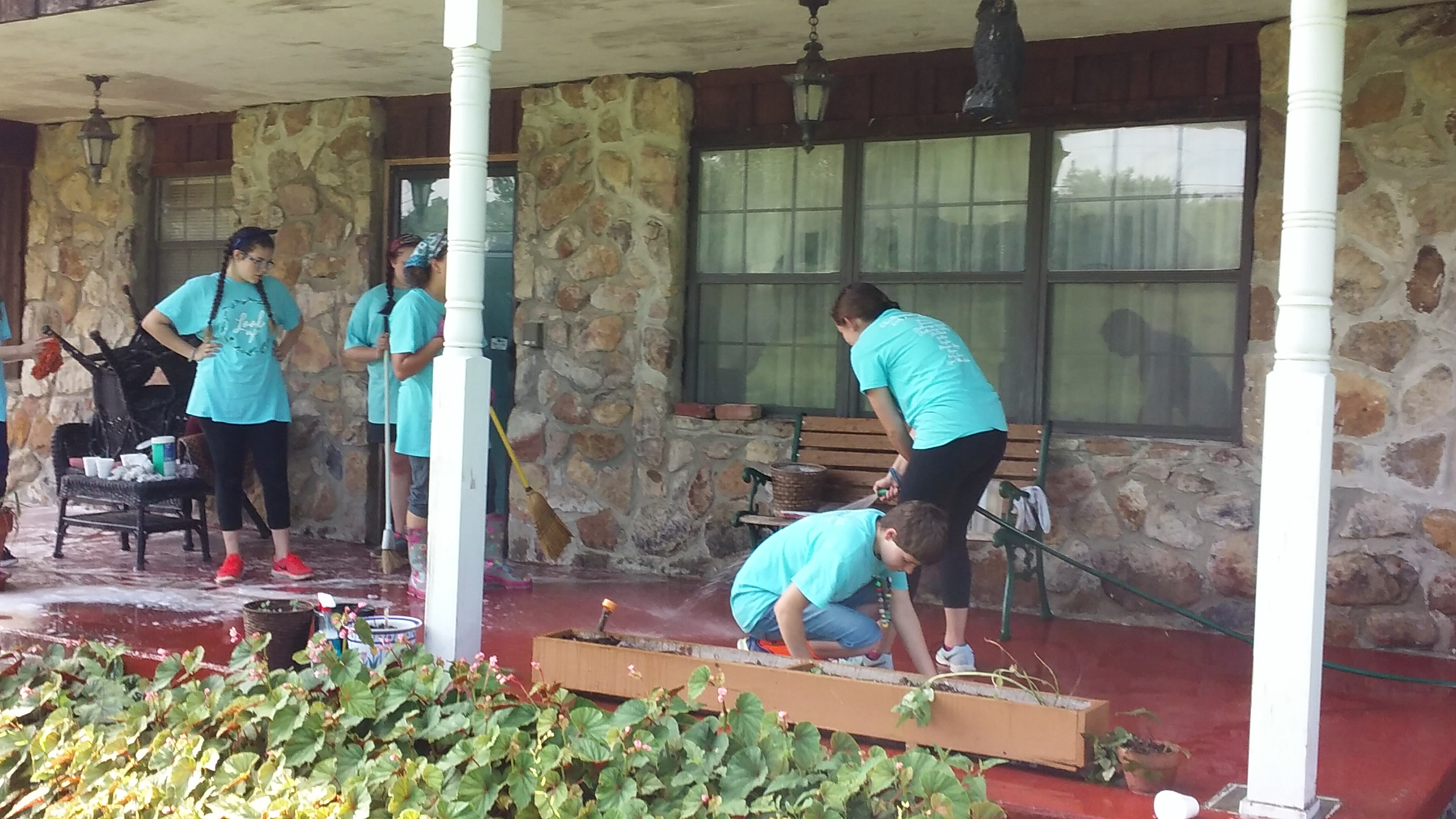 Homeowner's have yard cleaned with help from Catoosa Habitat and Latter-Day Saints